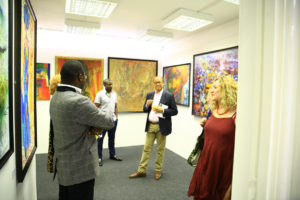 Visitors at the opening day of Chuck Gallery's Summer Exhibition, Seeing in Black and White