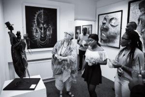 Visitors in the El Anatsui room at Chuck Gallery